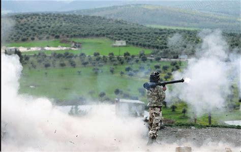 a turkish backed free syrian army fighter fires a